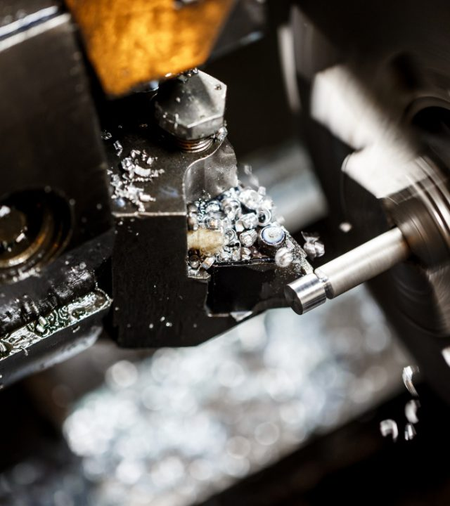 Close up photo of metalworking machine on plant.